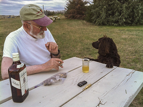 Norm discussing the finer points of cigars and scotch with Scarlett
