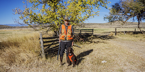 Russ and Tooey with our matching vests at Tucker Creek Ranch