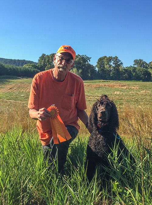 Carlin shows off his Master ribbon where Cooper showed off his pheasants. The sweat on my brow is from the heat and the anxiety of watching Carlin's water blinds.